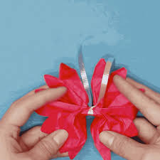 Peel away layers of tissue paper to create a puffy flower.
