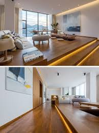 Wood Floor Layout Design Raised Platforms Help To Make This Open Plan Apartment Feel