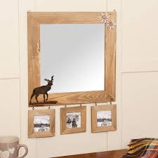 wooden wall mirror with deer detail and photo frames