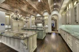 mediterranean chandeliers kitchen design luxury kitchen with arched brick ceiling off white cabinetry and crystal chandeliers style kitchen cabinets