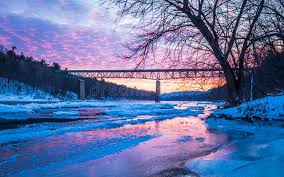 Icy Delaware River Reflects The Vivid Sunset Near Milford