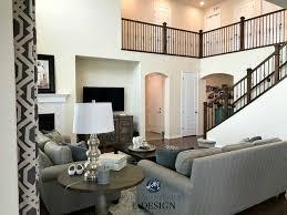 benjamin moore best cream navajo white in living room with dark stair railing south