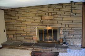 before applying paint to a textured surface it s important to brush out any dust from the crevices for a brick or stone fireplace there are a lot of