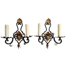 pair of early 20th c french rococo iron and gilt tole sconces