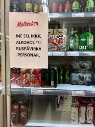 file hansa heineken beers etc in glass door refrigerator chiller showcase sign in norwegian nynorsk me sel ikkje alkohol til ruspåvirka personar we