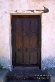 dark wooden door with no handle or door carmel mission carmel california