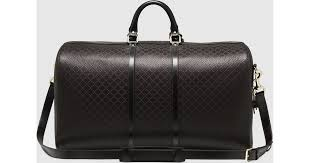 gucci bright diamante leather carry on duffle bag in brown for men lyst