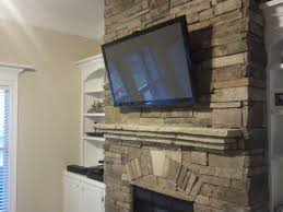 mounting tv over stacked stone fireplace image collections