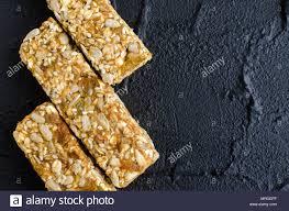 fitness tary food three homemade granola bars with oat flakes sesame sunflower and pumpkin seeds raisins honey on the shale pla