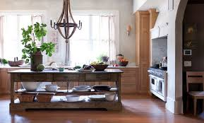european style kitchen with wood wine barrel chandelier and freestanding rustic kitchen island