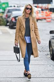 fashionista the 32 year old looked typically chic in a beige trench coat