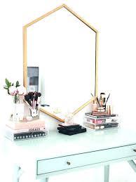 metal framed hexagon mirror rose gold white glove mirrored glass storage pots