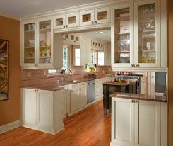 in style kitchen cabinets:  off white cabinets in casual kitchen by kitchen craft cabinetry
