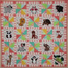 Zoo animal applique PDF baby quilt pattern easy pieced & Zoo animal applique PDF baby quilt pattern; easy pieced pinwheel block;  whimsical kid's elephant or panda or lion or giraffe quilt Adamdwight.com