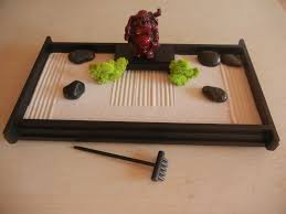 mini zen garden with mini statue and sand