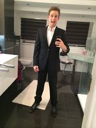 black pants white dress shirt black tie and a black jacket i have a pair of black leather shoes to go with it which are remnants from my high school