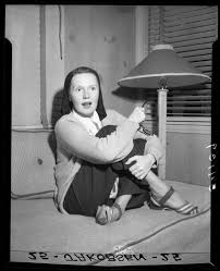 Actress Rita Johnson during interview after release from hospital, Balboa  Bay, Calif., 1948 — Calisphere