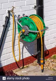 garden hose reel wall mount. A Garden Hose Reel With Yellow Kink Resisting Wall Mounted For Convenient Deployment - Stock Mount