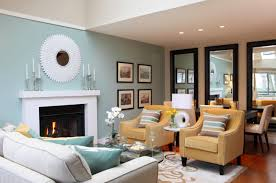cream couch living room ideas:  decorating ideas for a small living room mirror fireplace and soft blue and cream sofa set