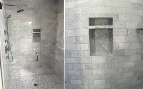 shower walls and a bathroom floor with white marble tiles