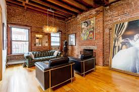 Kitchen And Living Room A 32 Foot Long Living Room With Exposed Brick Dominates This