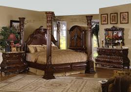 dark brown wooden canopy bed in carving accent complete with brown bedding set on brown wooden