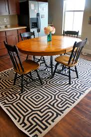 monochrome rug under dining table