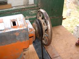 electric grindstone. had to make up some shims fit the sewing machine pulley grinder. electric grindstone