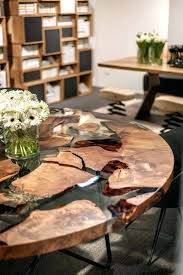 a stunning round dining table with live wood edge and resin metal legs is uk