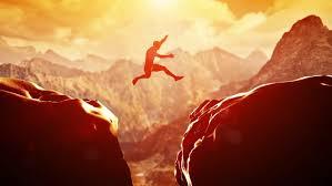 freeze frame of man jumping stock