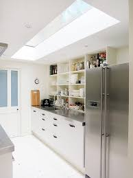 ... Narrow kitchen looks a lot more spacious thanks to the skylight  [Design: Mad About