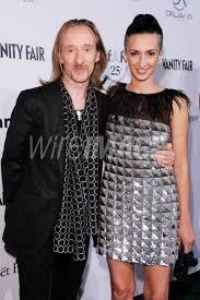John Richmond and Elena Berra attends amfAR MILANO 2011 at La ...