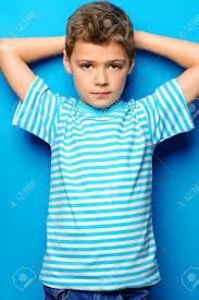 portrait of a cute boy over bright blue background clothes for children kid s fashion