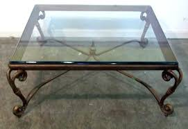 luxury iron glass coffee table classic square top with ornate legs on grey concrete floor round
