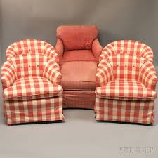 four matching upholstered barrel back chairs and a similar printed cotton upholstered armchair and ottoman estimate 200 400