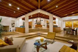 architecture interior design with amazing wooden ceiling for living room  with beige sofa and classic ottoman