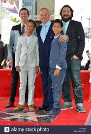 Chef Wolfgang Puck (center) and his sons Byron, Alexander, Oliver and  Cameron pose with his star during the unveiling ceremony honoring Puck with  the 2,608th star on the Hollywood Walk of Fame