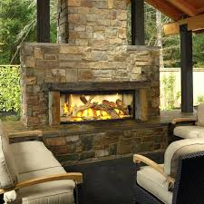 natural gas fireplace mantel contemporary rustic style outdoor stony fireplace design with cozy cream cushions seat