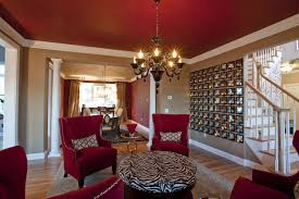 epic decorating ideas using rectangular red suede club chairs and black glass