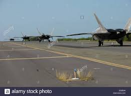 Four F-22 Raptors from the 199th and 19th Fighter Squadrons taxi ...
