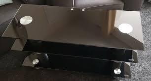 serano black tempered glass 3 tier slimline tv stand has chrome legs