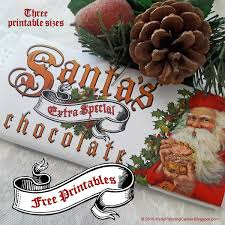 A bit of extra imagery is included on the ends of the wrappers; Free Printable Christmas Chocolate Bar Wrappers Edible Crafts