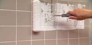 rolling paint on a ceramic tile wall