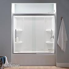 Seamless tub surround Ceiling Tub Surrounds Seamless Shower Doors How To Buy New Bathtub And Surround The Family Handyman
