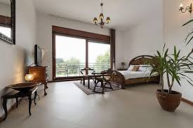 you can see from this picture that a simple small area rug can make a huge statement in such an elegant bedroom the brown of the rug matches the rest of