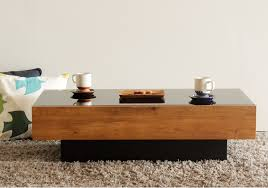 center table with black glass shelf and drawer