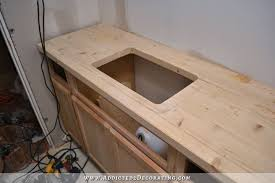 diy pine butcherblock style countertop with hole cut out for undermount sink