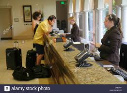 orlando florida rosen shingle creek hotel resort lobby check in desk woman reservations reception employee job service industry