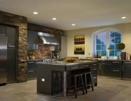 black and stainless kitchen kitchen with black cabinets and stainless steel appliances and recessed lighting