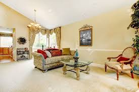Ivory Living Room Furniture Spacious Ivory Living Room With High Vaulted Ceiling And Carpet
